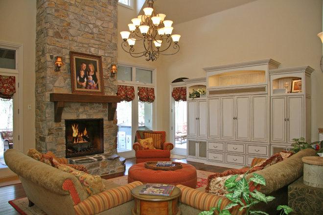 Rustic Family Room by Landmark Builders
