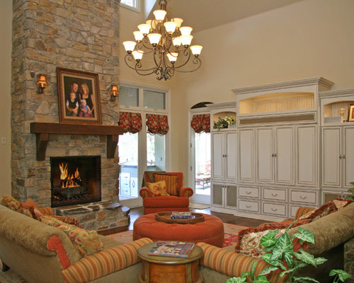 Mountain Style Family Room Photo In Sacramento With A Stone Fireplace Surround