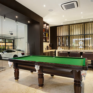 Expansive contemporary open plan family and games room in Melbourne with beige walls and a game room.