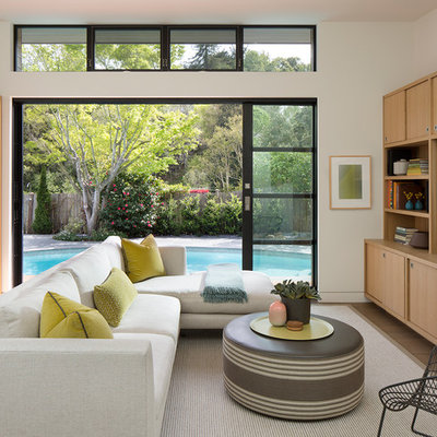 Inspiration for a mid-sized contemporary open concept family room remodel in San Francisco with white walls and a media wall