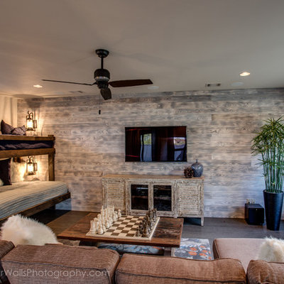 Inspiration for a mid-sized rustic enclosed medium tone wood floor family room remodel in Austin with a bar, beige walls, no fireplace and a wall-mounted tv