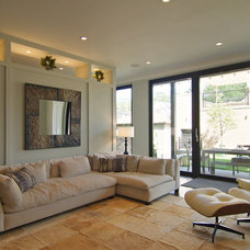 Transitional Family Room by Besch Design, Ltd.