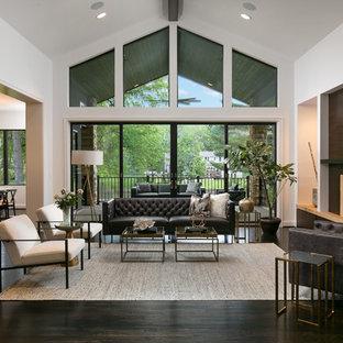 Idées déco pour une grand salle de séjour classique ouverte avec un mur blanc, un sol en bois foncé, un manteau de cheminée en pierre, un téléviseur fixé au mur, un sol marron et une cheminée ribbon.