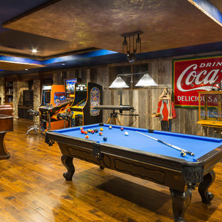 Rustic family and games room in Kansas City with a game room.