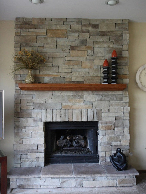 stone veneer for fireplaces. Example of a classic family room design in Chicago Stone Veneer Fireplace  Houzz