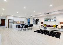 Are floors natural wood, vinyl or tiles?