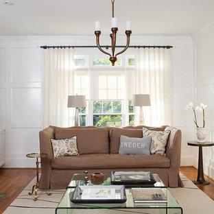 Foto de sala de estar abierta, escandinava, de tamaño medio, con marco de chimenea de piedra, paredes blancas, suelo de madera en tonos medios, chimenea tradicional y televisor colgado en la pared