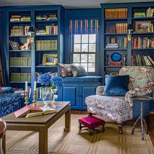 Foto di un soggiorno boho chic con libreria