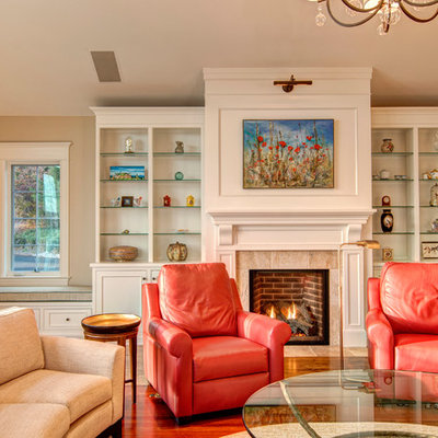 Example of a classic dark wood floor family room design in Other with beige walls, a standard fireplace and a tile fireplace