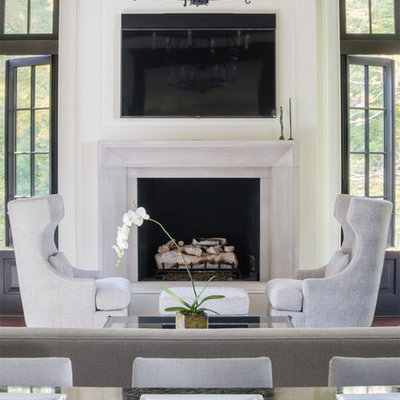 Elegant open concept dark wood floor family room photo in DC Metro with white walls, a standard fireplace, a stone fireplace and a wall-mounted tv