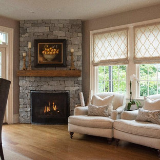 Family room - large transitional open concept medium tone wood floor family room idea in New York with a corner fireplace, a stone fireplace and gray walls