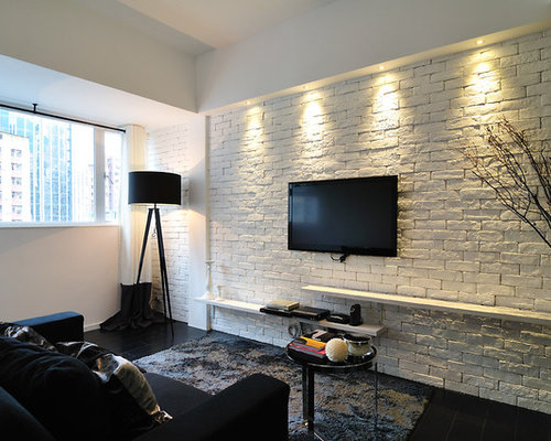 Inspiration For A Contemporary Family Room Remodel In Hong Kong With White  Walls, A Wall