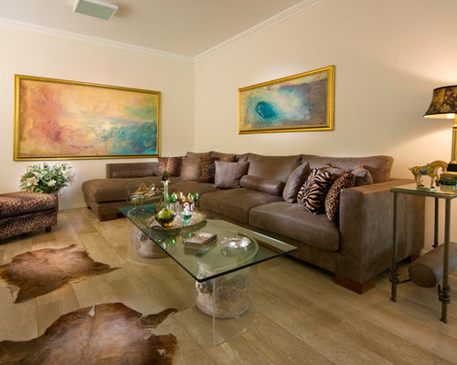 Trendy Medium Tone Wood Floor Family Room Photo In Other With Beige Walls