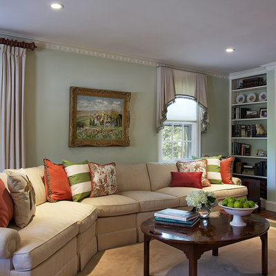 Family room - traditional family room idea in New York with green walls
