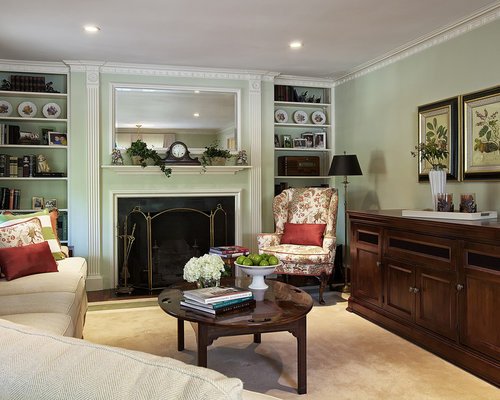 Example Of A Classic Brown Floor Family Room Design In New York With Green Walls