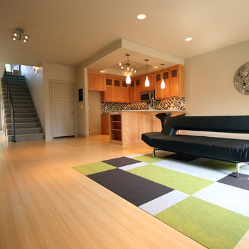 Living Room + Kitchen + Eating Area in Urban townhome
