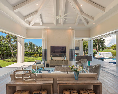 Inspiration For A Beach Style Medium Tone Wood Floor And Gray Floor Living  Room Remodel In