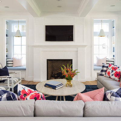 Inspiration for a large coastal open concept light wood floor and brown floor family room remodel in Minneapolis with white walls, a standard fireplace, a wall-mounted tv and a wood fireplace surround
