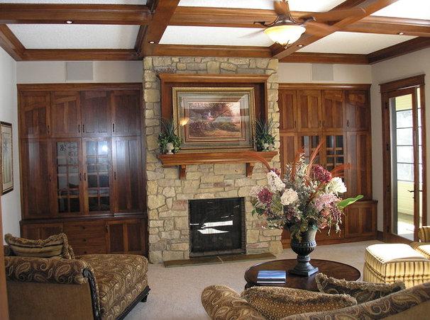 Rustic Family Room by Minnetonka Custom Homes, Inc