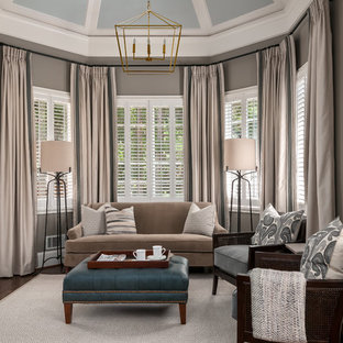 Example of a mid-sized classic enclosed dark wood floor and brown floor family room design in Atlanta with beige walls