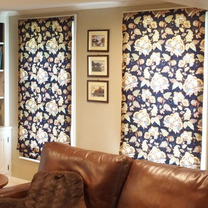 Living Room with indigo blue print Roman shades
