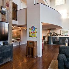 Industrial Family Room by Besch Design, Ltd.