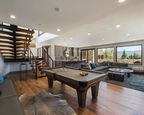 example of a mountain style open concept medium tone wood floor game room design in salt - Game Room Design Ideas