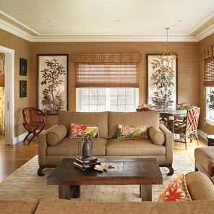 Inspiration for a large transitional enclosed medium tone wood floor family room remodel in New York with beige walls