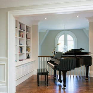 Example of a classic loft-style medium tone wood floor family room design in Toronto with a music area, gray walls and no tv