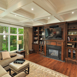 Family room - contemporary enclosed dark wood floor family room idea in Toronto with beige walls, a standard fireplace and a wall-mounted tv