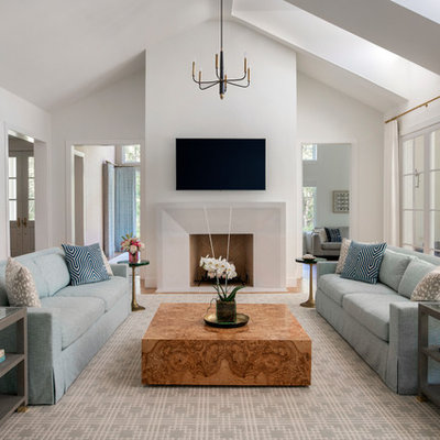 Family room - large transitional enclosed light wood floor family room idea in Dallas with white walls, a standard fireplace, a stone fireplace and a wall-mounted tv