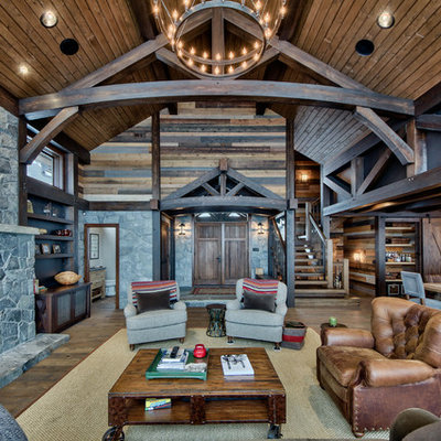 Example of a large mountain style open concept medium tone wood floor family room design in Vancouver with a standard fireplace, a stone fireplace and a wall-mounted tv