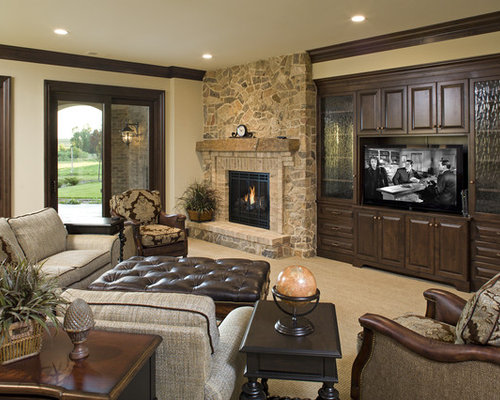 Example Of A Classic Family Room Design In Minneapolis With Stone Fireplace Surround