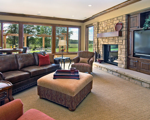 Elegant Family Room Photo In Minneapolis With A Stone Fireplace Surround