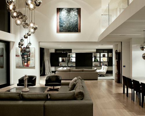 minotti lighting. Example Of A Trendy Open Concept Light Wood Floor Family Room Design In Auckland With White Minotti Lighting