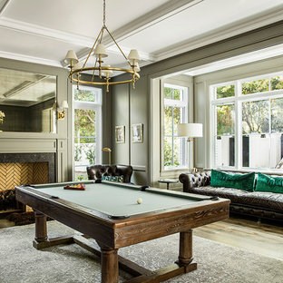 Game room - traditional dark wood floor game room idea in Los Angeles with gray walls and a standard fireplace