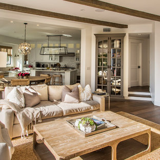 Beach style open concept medium tone wood floor and brown floor family room photo in Los Angeles with white walls and a wall-mounted tv