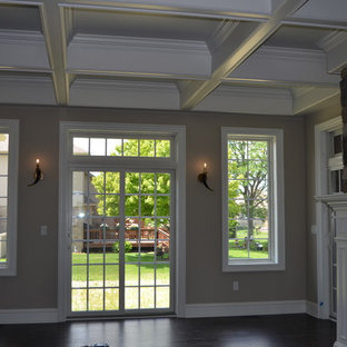 Example of a transitional family room design in Detroit