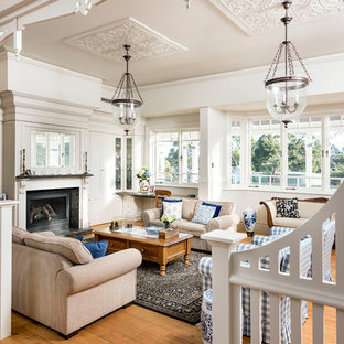 Photo of a country family room in Perth with white walls, medium hardwood floors, a standard fireplace and no tv.
