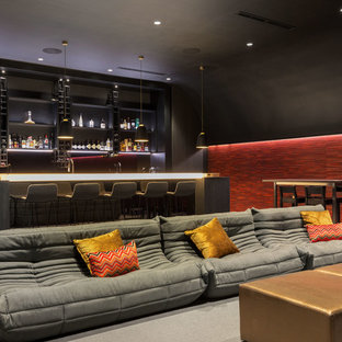 Contemporary family room in Perth with a home bar, black walls, carpet and grey floor.