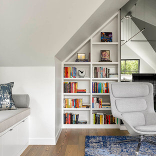 Example of a large trendy enclosed medium tone wood floor and green floor family room library design in Dallas with white walls