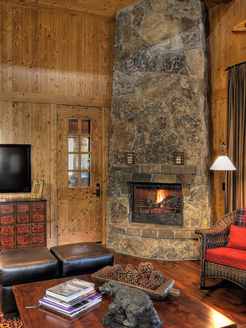 Example of a mountain style family room design in Phoenix with a corner  fireplace and a