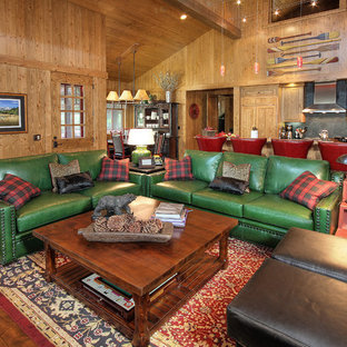 Inspiration for a rustic open concept medium tone wood floor and brown floor family room remodel in Phoenix