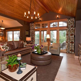 Example of a mid-sized mountain style open concept light wood floor family room design in Portland with brown walls, no fireplace and no tv