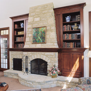 Elegant family room photo in Columbus with a stone fireplace