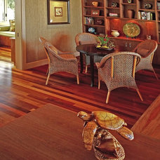 Tropical Family Room by Fine Design Interiors, Inc