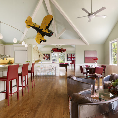 Example Of An Eclectic Open Concept Medium Tone Wood Floor Family Room  Design In San Francisco