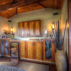 Tropical Family Room by bobby vilas design