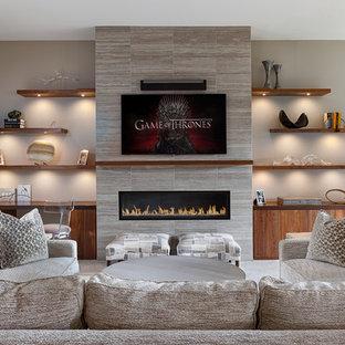 Réalisation d'une salle de séjour tradition de taille moyenne et ouverte avec un mur gris, une cheminée ribbon, un manteau de cheminée en carrelage et un téléviseur fixé au mur.