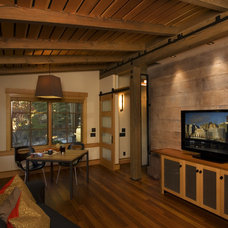 Rustic Home Theater by Ryan Group Architects